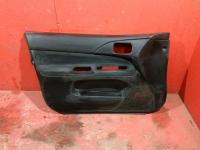 Обшивка передней левой двери Mitsubishi Lancer 9